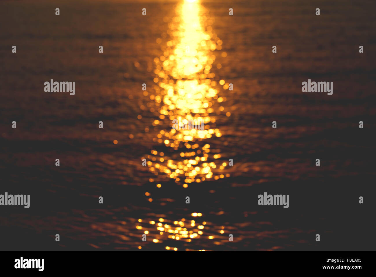 a sun glare on the water, beautiful background - Stock Image