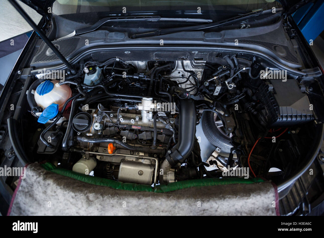 Cars with open hood for servicing - Stock Image
