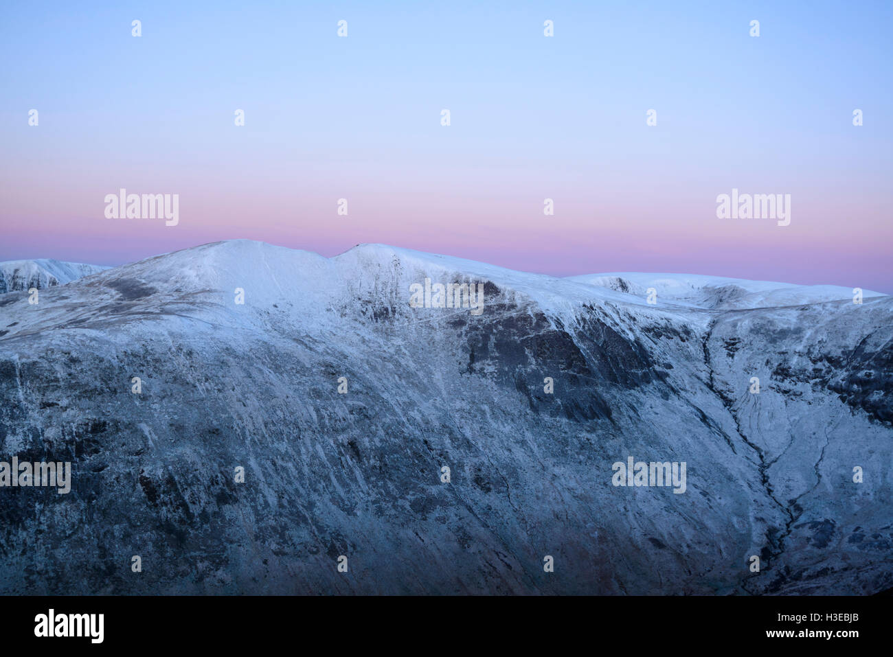 Dawn, the twin peaks of Saddle Yoke (left) and Under Saddle Yoke (right), with Hart Fell (behind right) - Stock Image