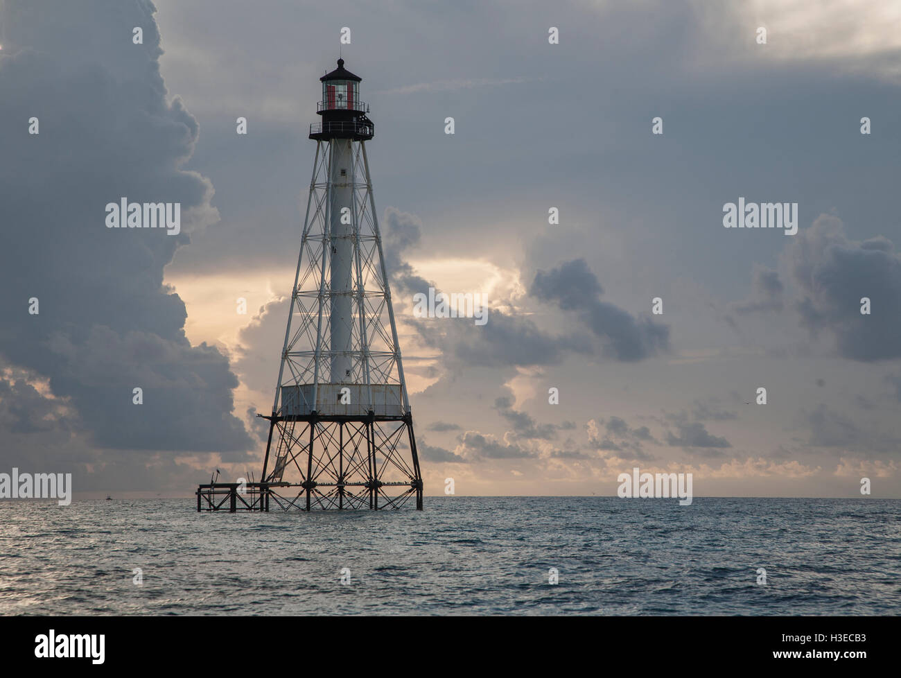 Alligator Reef Light stands quietly in early light as it has since 1873 guarding the shallow reef  where its namesake - Stock Image