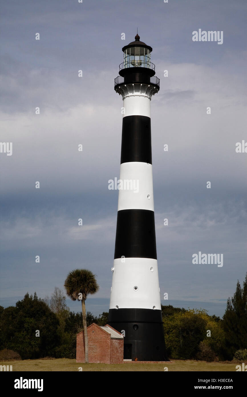 The distinctive black and white bands of the cast iron tower of Cape Canaveral Light are striking against the stormy - Stock Image