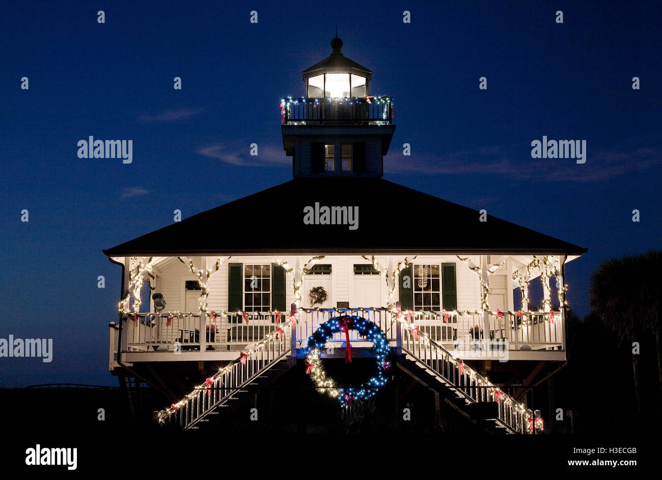 Boca Grande Lighthouse decked out for the holidays with wreath & strings of pretty lights & its white beacon - Stock Image