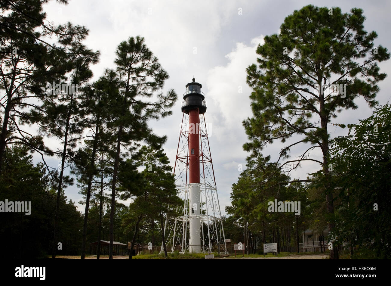 The red and white tower of Crooked River Lighthouse aka Carrabelle Light on Florida's Gulf Coast stands 100' - Stock Image