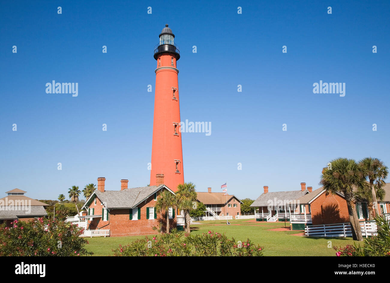 The 175 foot orange masonry tower of Ponce de Leon Inlet Lighthouse is the tallest in Florida, once called Mosquito - Stock Image