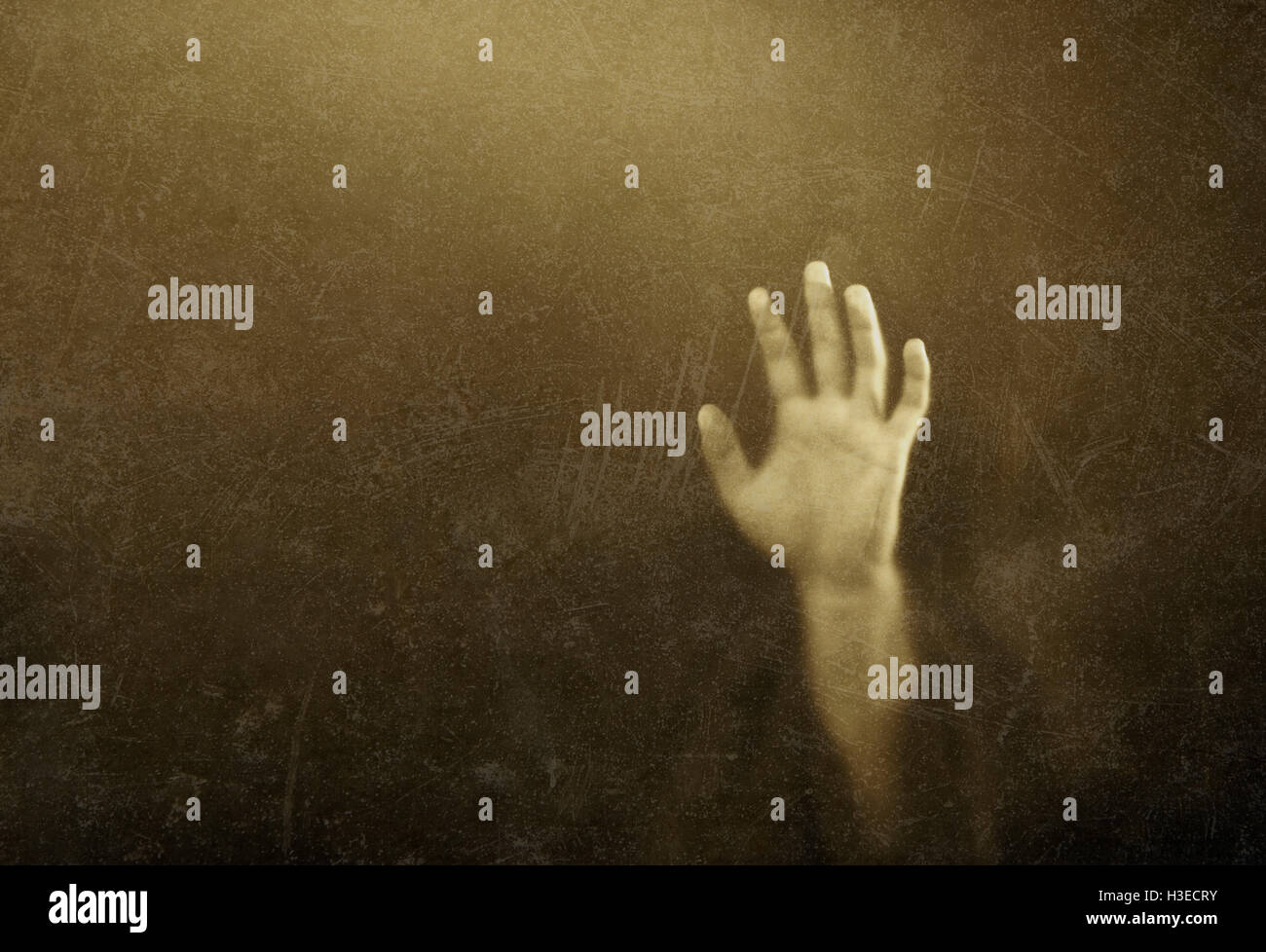Shadowy figure behind dusty scratched glass - Stock Image