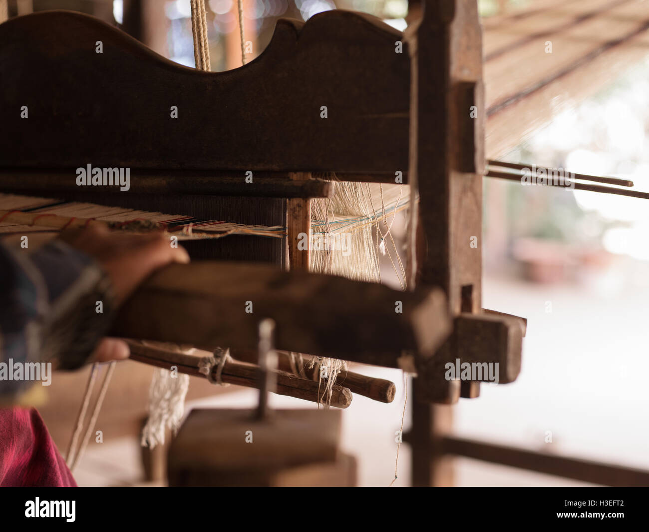 Closeup of the process of weaving in Bagan Villages, Myanmar (Burma) - Stock Image