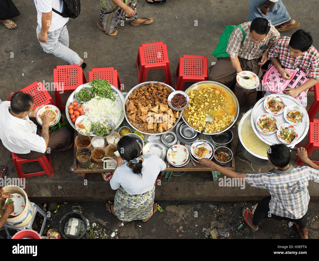 Townspeople gather for a community feast in Yangon, Myanmar (Burma) - Stock Image