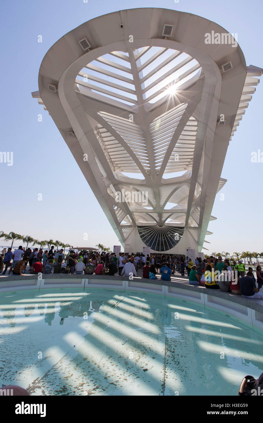 People enjoy the sunny day beside The Museum of Tomorrow ( Museu do Amanha ) at Pier Maua, next to the  revitalized - Stock Image