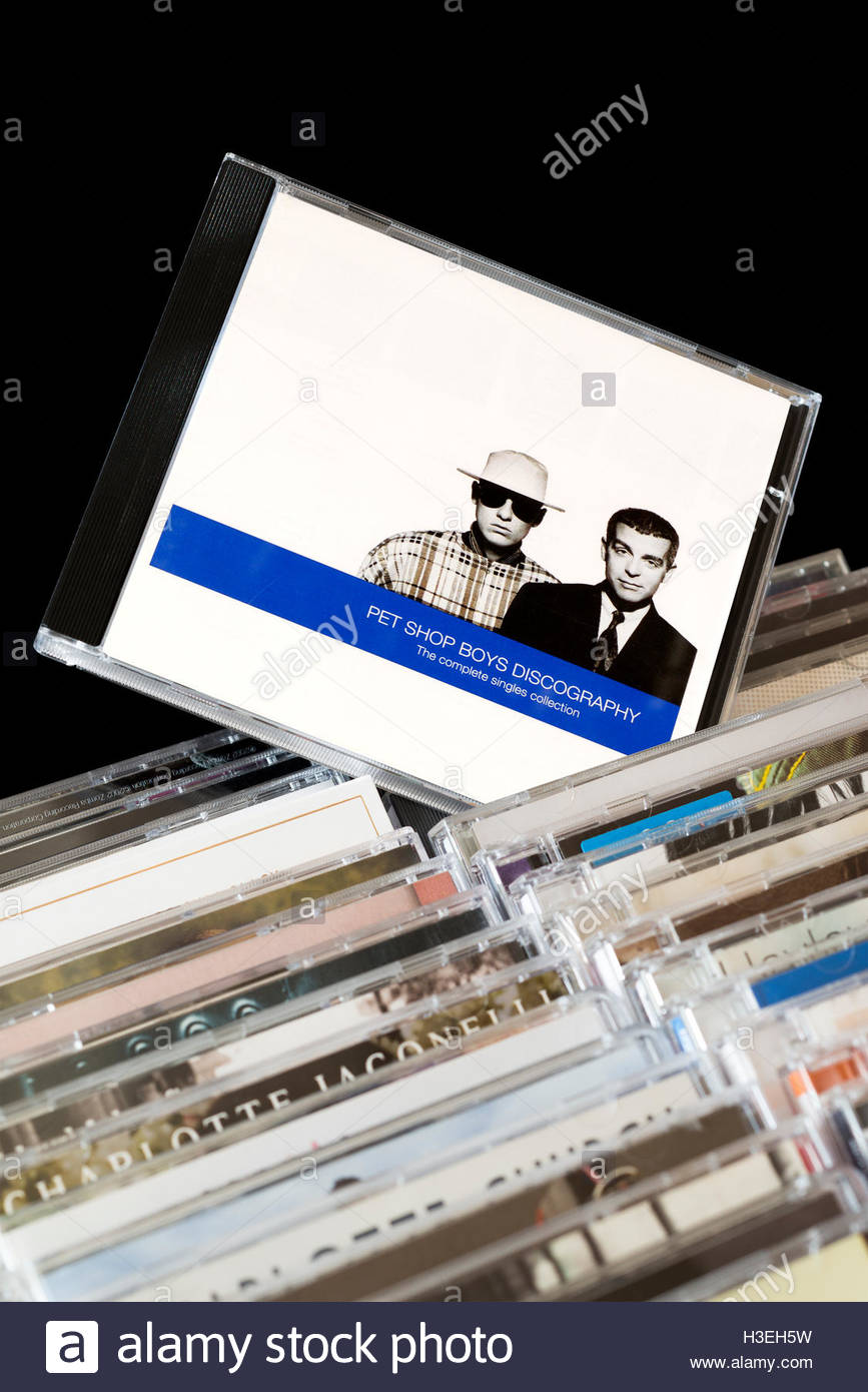 The Complete Singles Collection 1991 Pet Shop Boys-Discography CD pulled out from among rows of other CD's - Stock Image