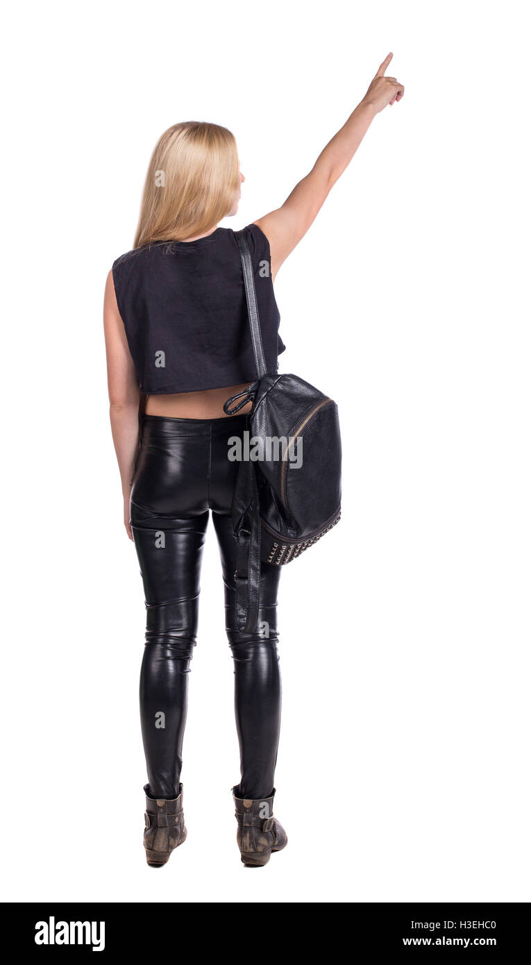 2c964e1b40 Back view of pointing woman with a backpack. beautiful girl. Rear view  people collection