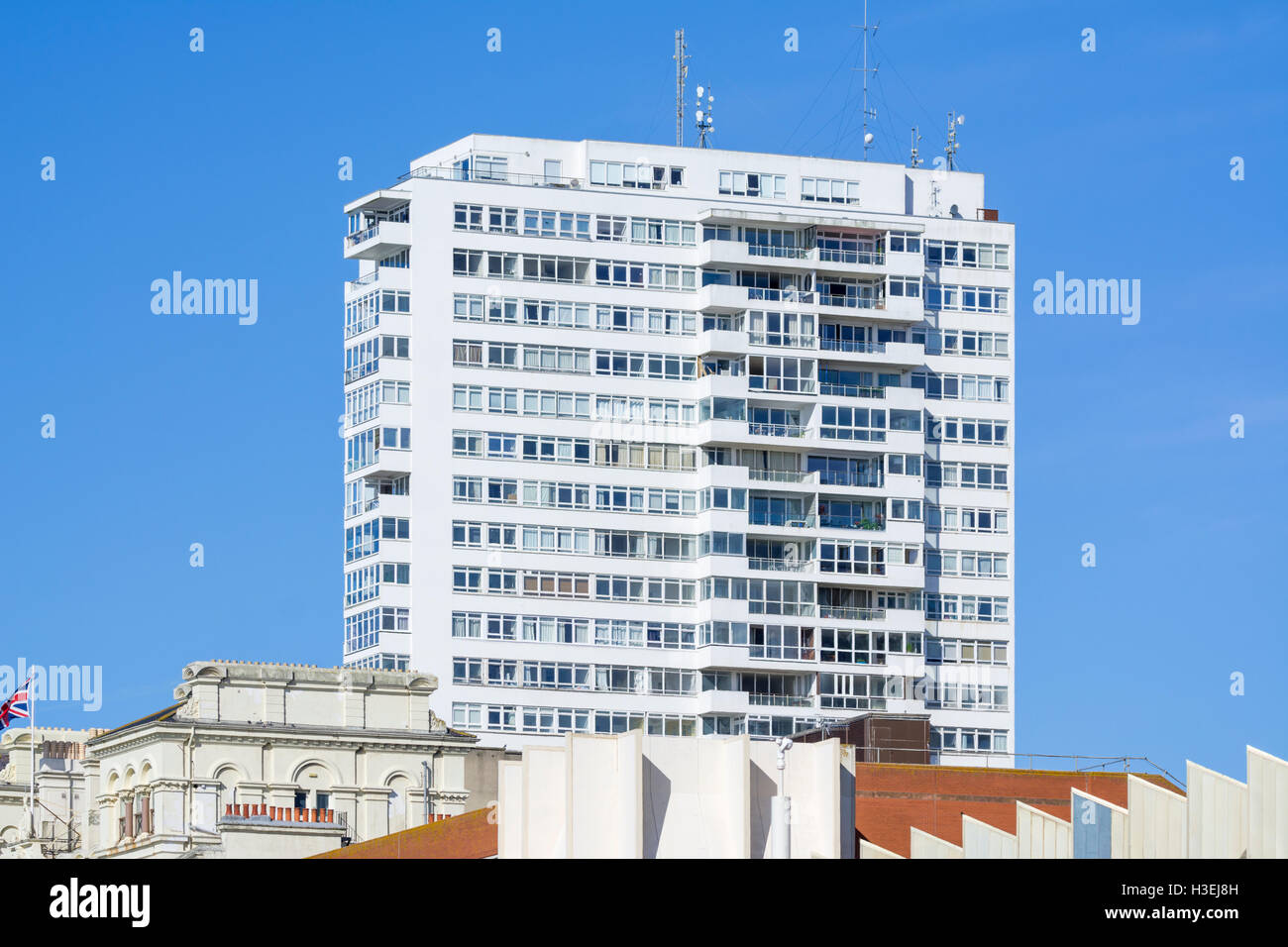 High rise office building block with housing in foreground in Brighton, East Sussex, England, UK. - Stock Image