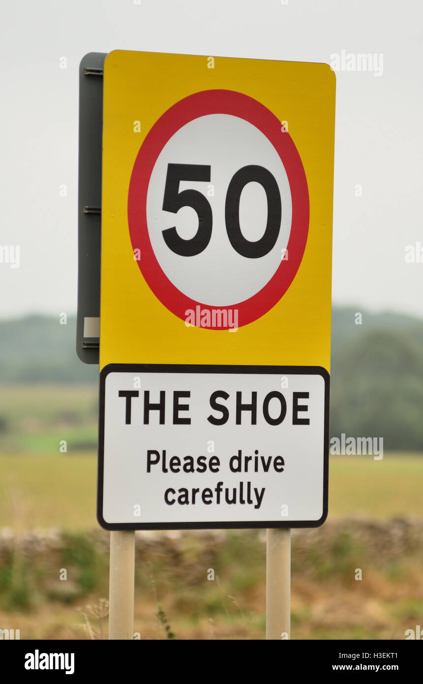 Start of speed limit sign at The Shoe, a small hamlet on the A420 between Chippenham and Bath. Stock Photo