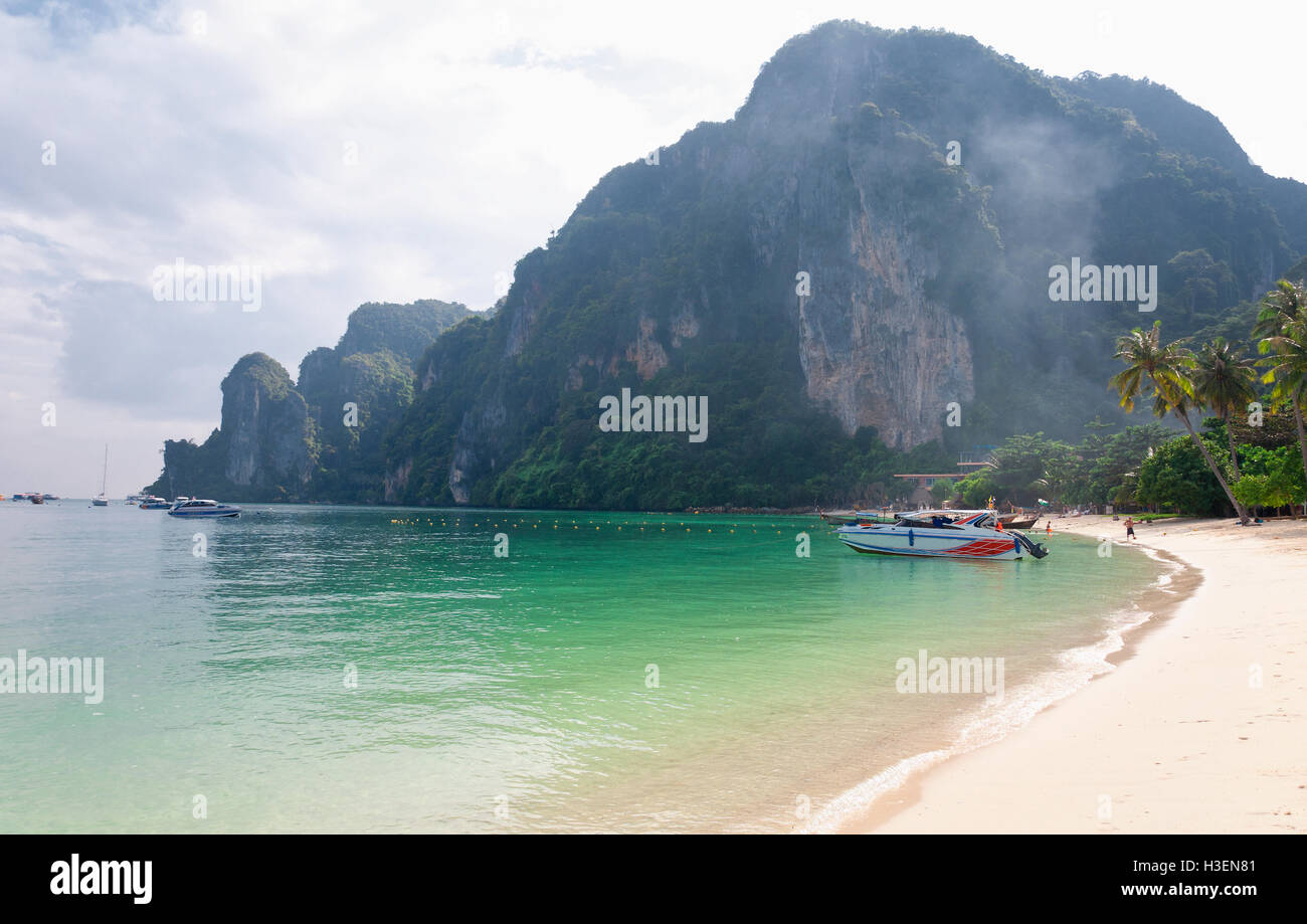 A beach on Phiphi Don island in the Andaman Sea in Thailand on a blue sky summer day. - Stock Image