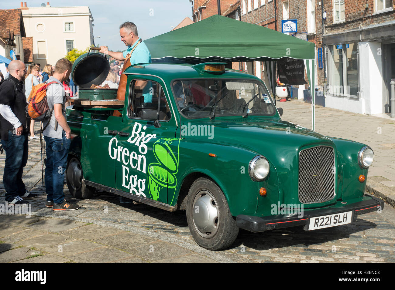 A Converted Taxi The Big Green Egg Barbecue at the Thame Festival of Food Oxfordshire England United Kingdom UK - Stock Image