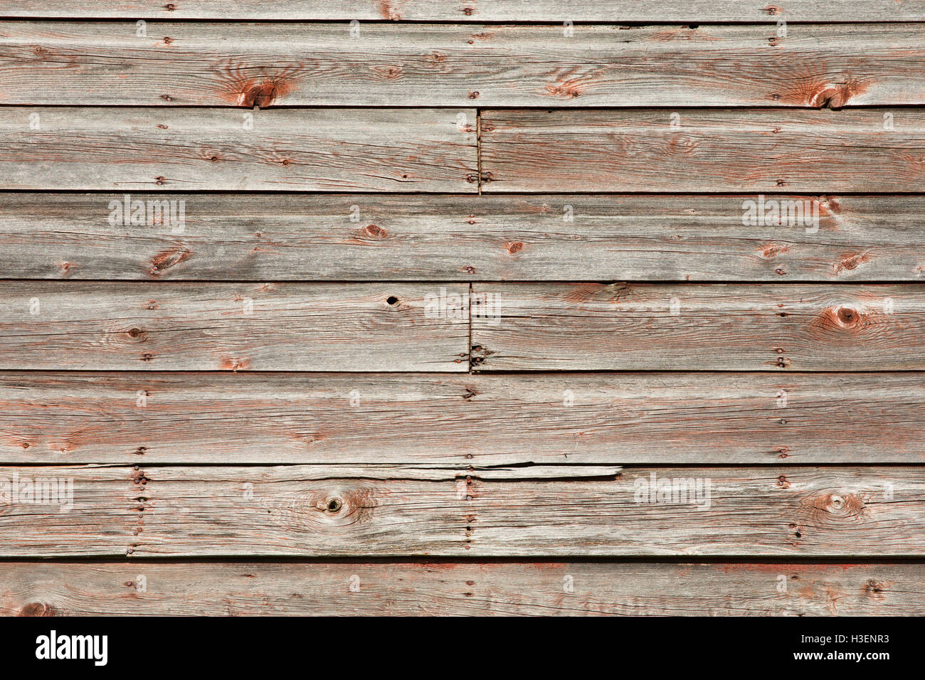 Weathered Barn Wood Siding Background. Lots Of Texture And Detail In Rustic  Red And Gray.