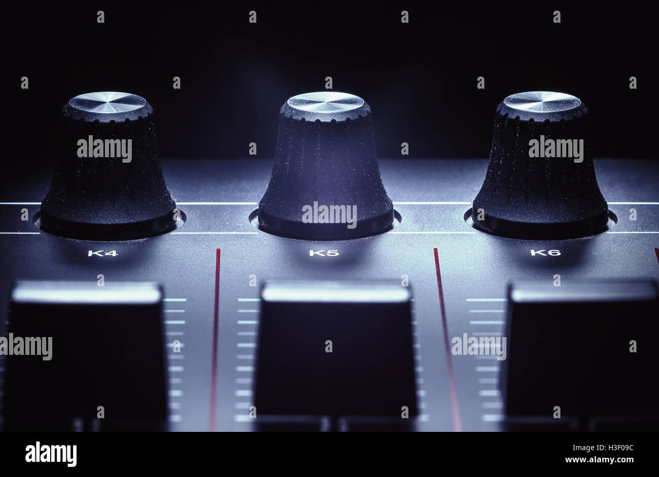 Details of a modern midi controller, view on sliders and knobs. - Stock Image