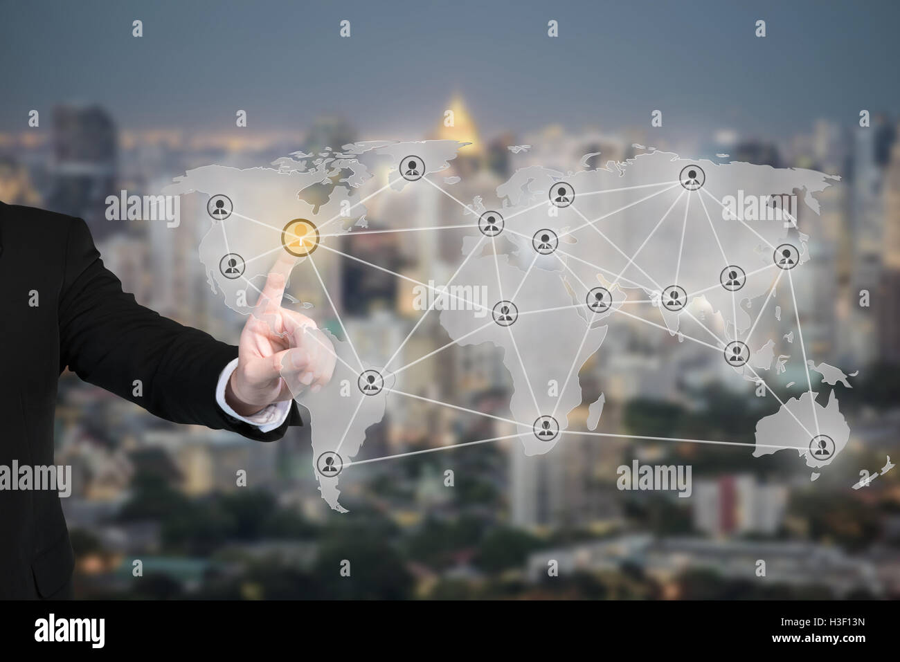 Businessman pressing modern social partnership network connection buttons on avirtual background. Partnership network - Stock Image