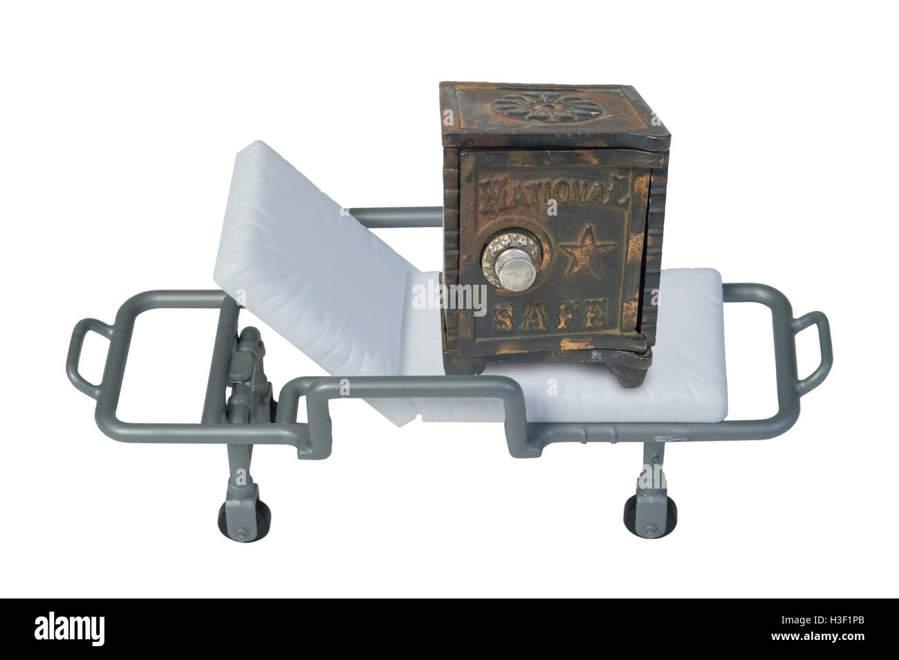 Vintage Safe on a hospital gurney to show investment health - path included - Stock Image