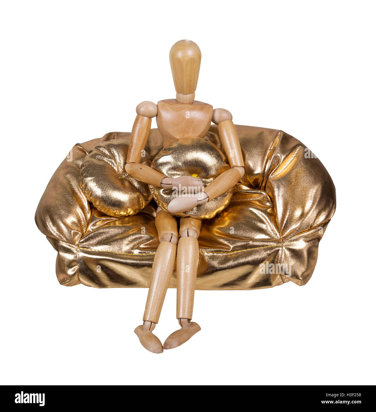 Sitting on a golden plump couch for resting and relaxing - path included - Stock Image