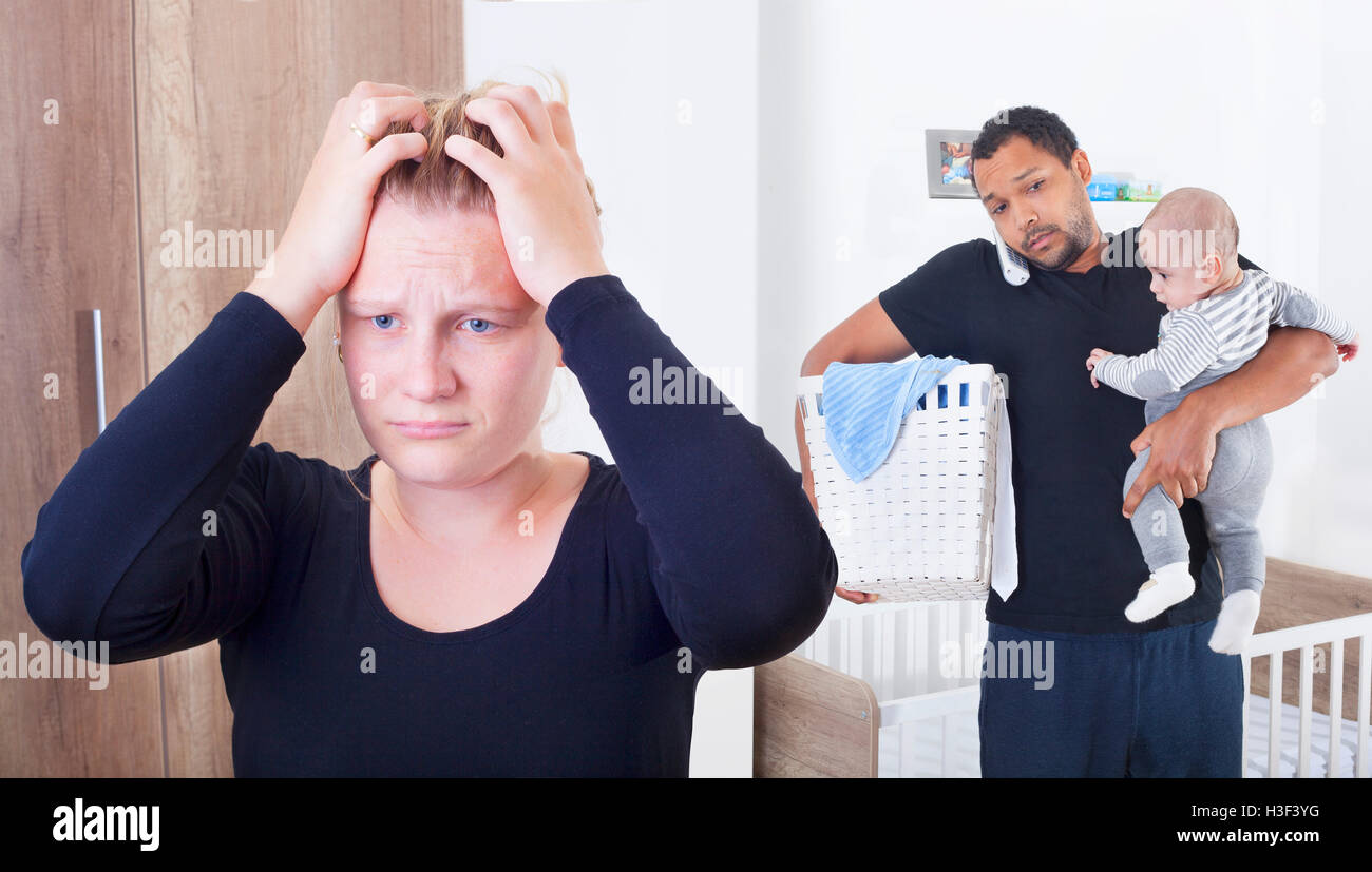 Husband overwhelmed by taking care of everything alone, because his wife is suffering from postpartum depression - Stock Image