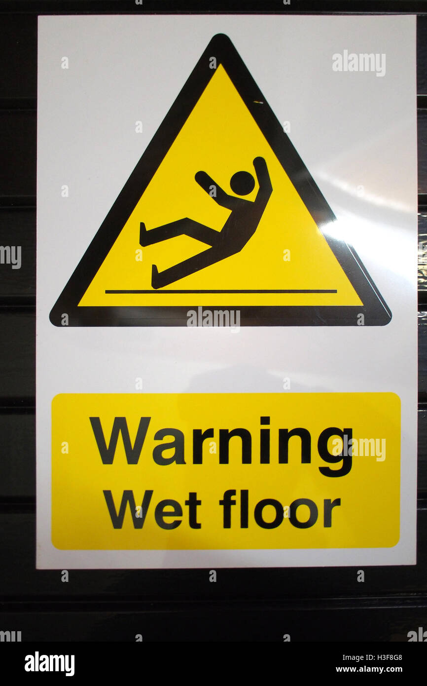 Caution Wet Floor SLIPPERY ! warning sign - Stock Image