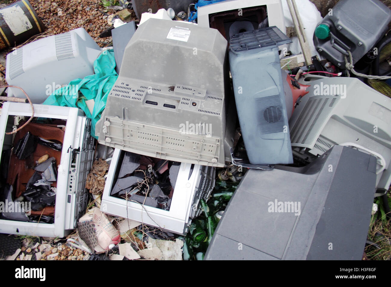 old abandoned broken Television sets - Stock Image