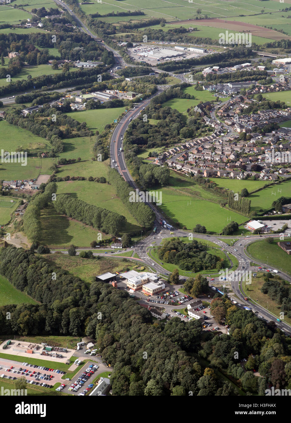 aerial view of A6 A66 roundabout road junction at Penrith, with junction 40 of the M6 motorway in the background, - Stock Image