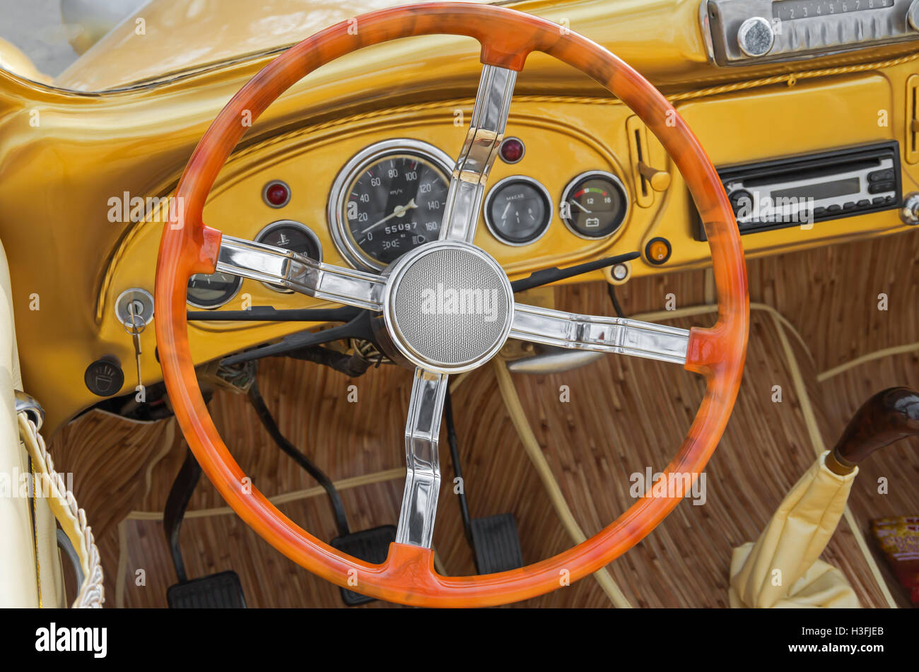 Driving position vintage yellow car after a recent upgrade - Stock Image