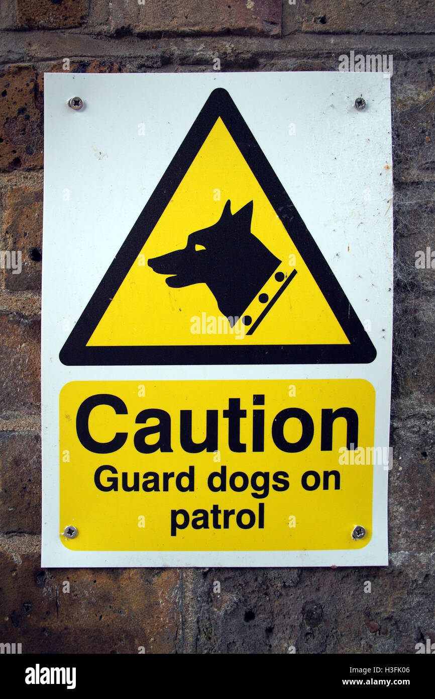 Caution GUARD DOG PATROL ! warning sign - Stock Image