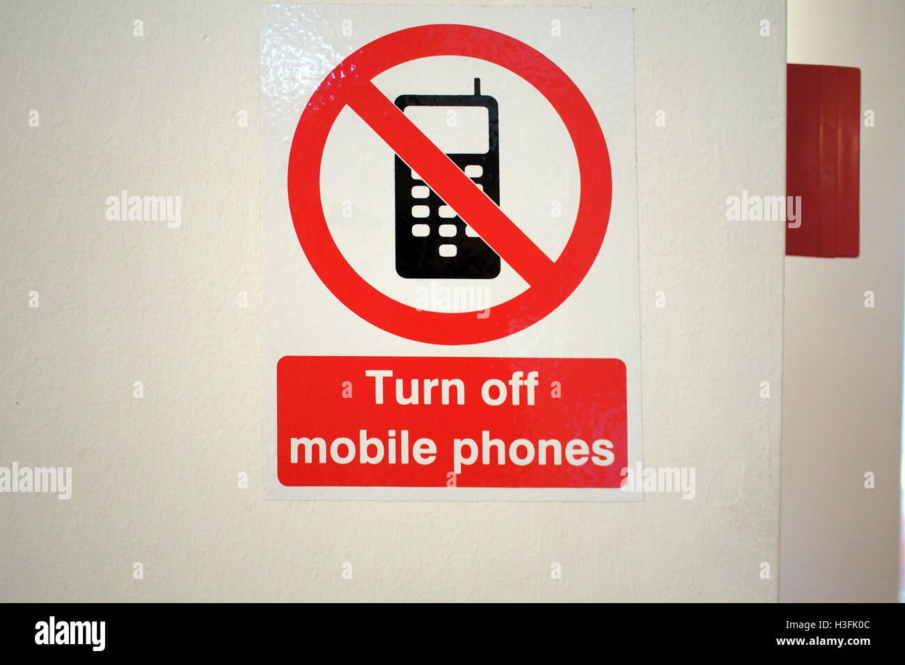 Turn off Mobile Phones prohibited warning sign - Stock Image