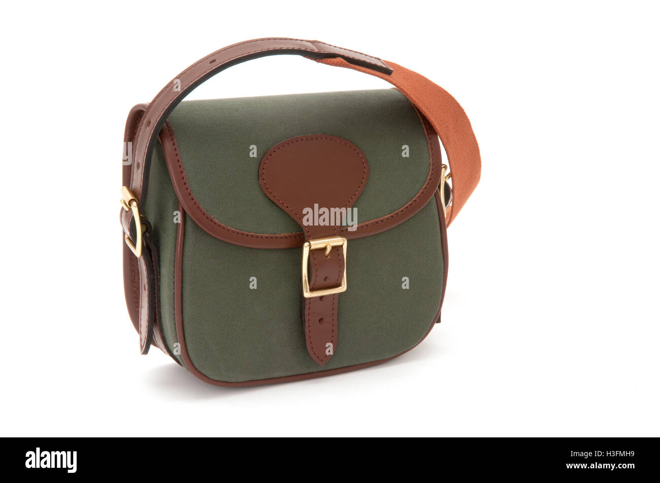 Cutout of green cotton canvas handbag or purse - Stock Image