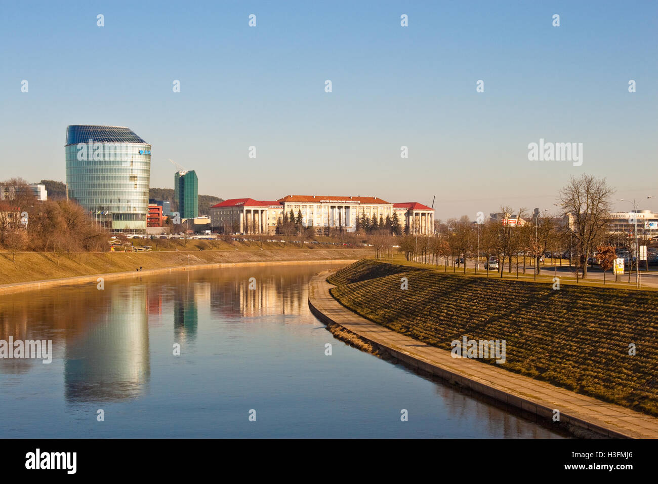 Vilnius, Lithuania - March 16, 2015: Lithuanian University of Educational Sciences and a modern building of Barclays - Stock Image