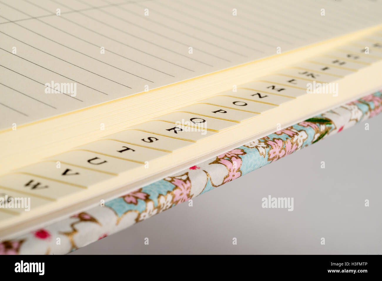 closeup of the tab index of a blank address book stock photo