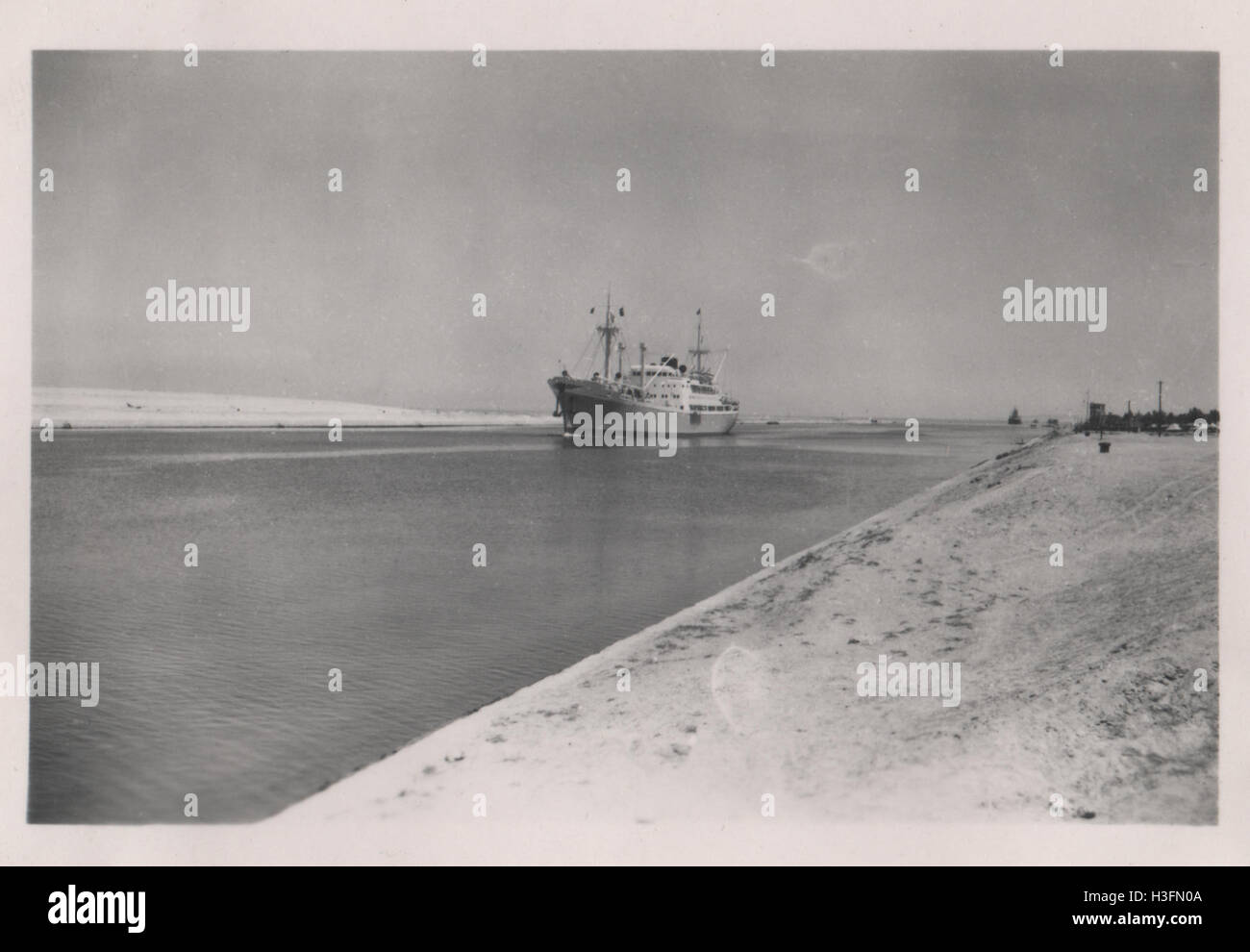 The cargo ship Ile Maurice transiting the Suez Canal in the area of the Great Bitter Lake in 1952 in the period - Stock Image