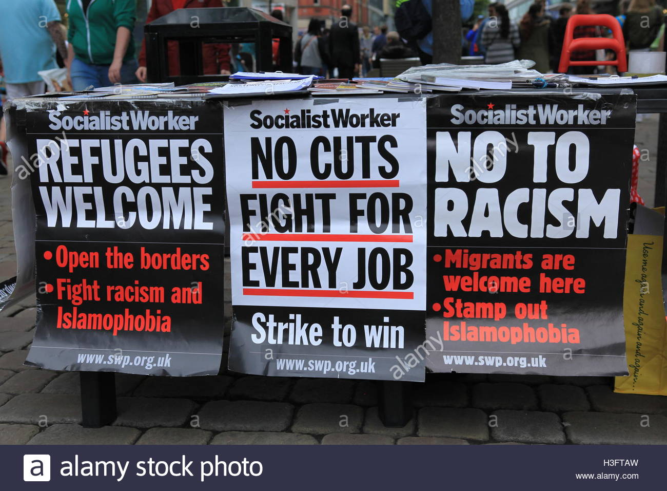The Socialist Newspaper On The Streets Of Manchester Promoting Social Awareness Regarding Refugees, Racism And Employment - Stock Image