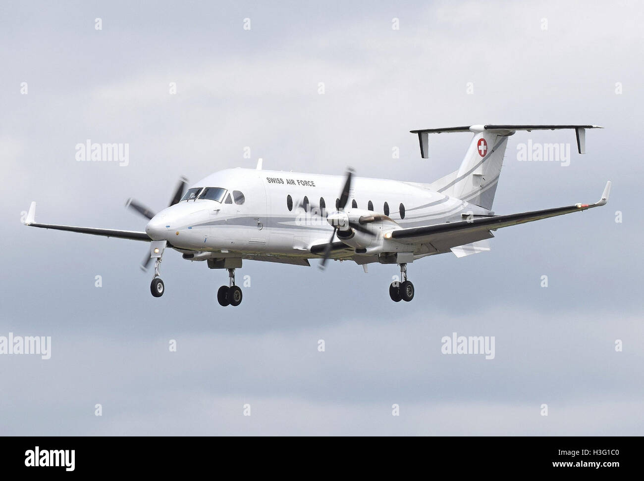 Beechcraft 1900D (code T-729) of the Swiss Air Force arrives Fairford 7Jul2016 arp - Stock Image