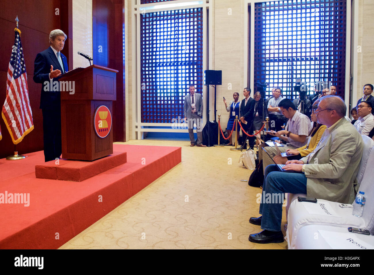 U.S. Secretary of State John Kerry listens to a question from Associated Press reporter Matt Lee at the National - Stock Image