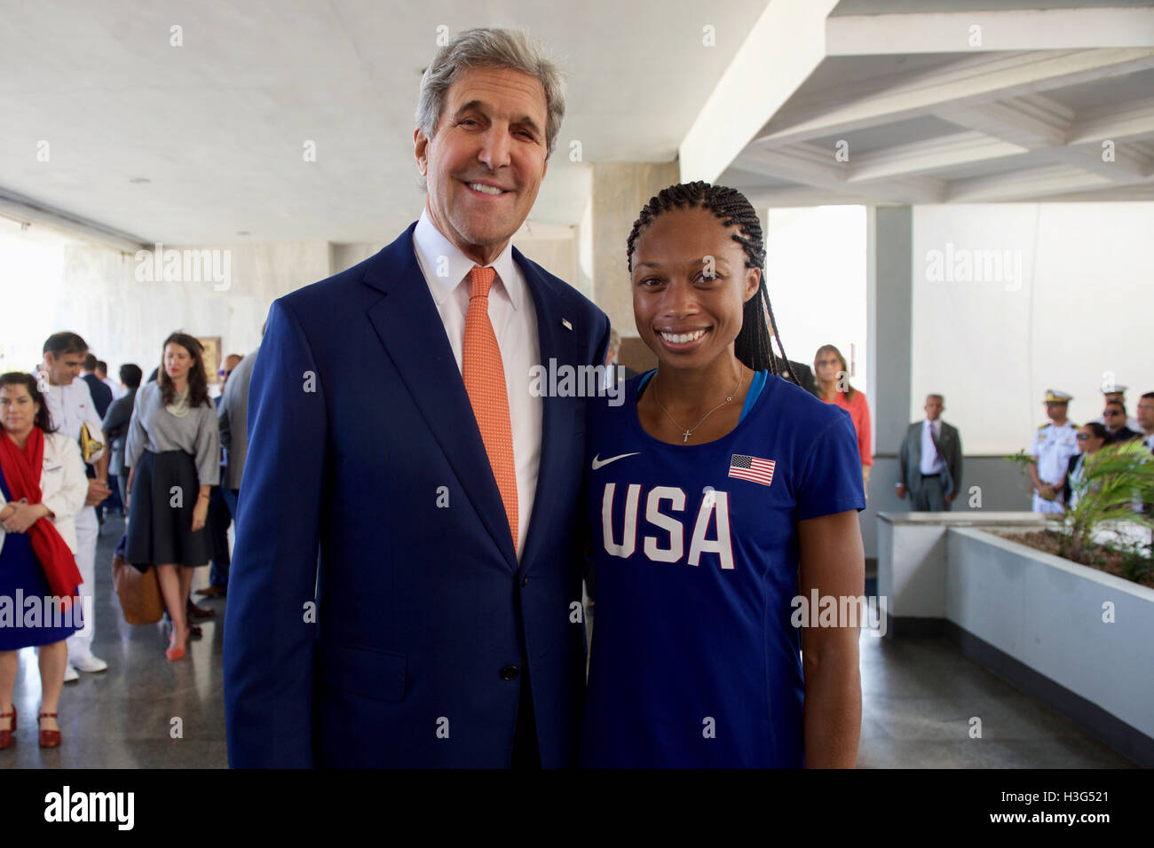 U.S. Secretary of State John Kerry poses for a photo with Olympic gold medalist and track star Allyson Felix as - Stock Image