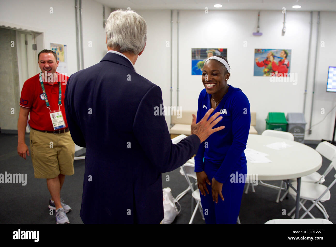 U.S. Secretary of State John Kerry greets Olympic women's  tennis player Sloane Stephens at Olympic Park in - Stock Image