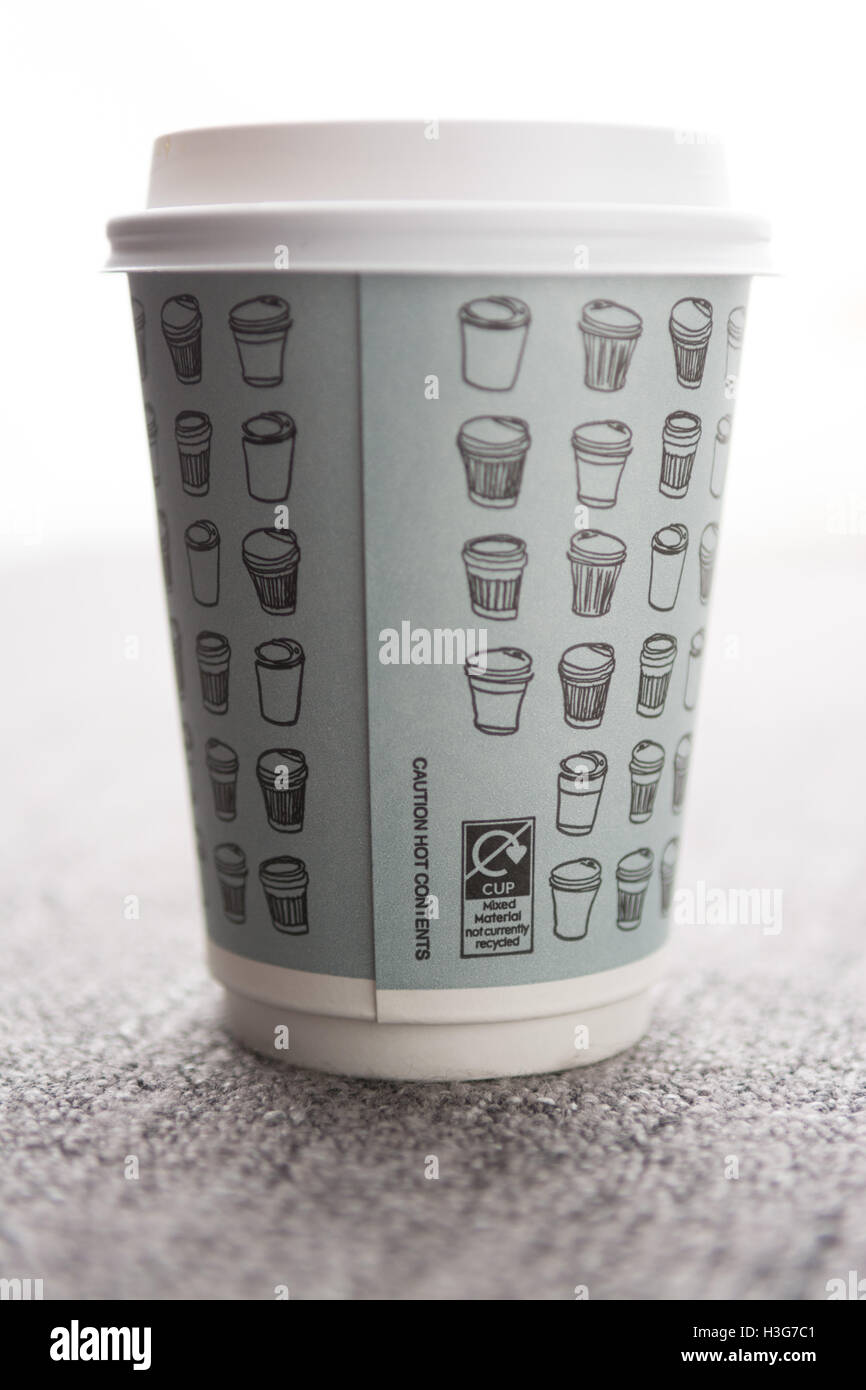 'mixed material not currently recycled' labelling on disposable paper takeaway coffee cup from Waitrose - Stock Image