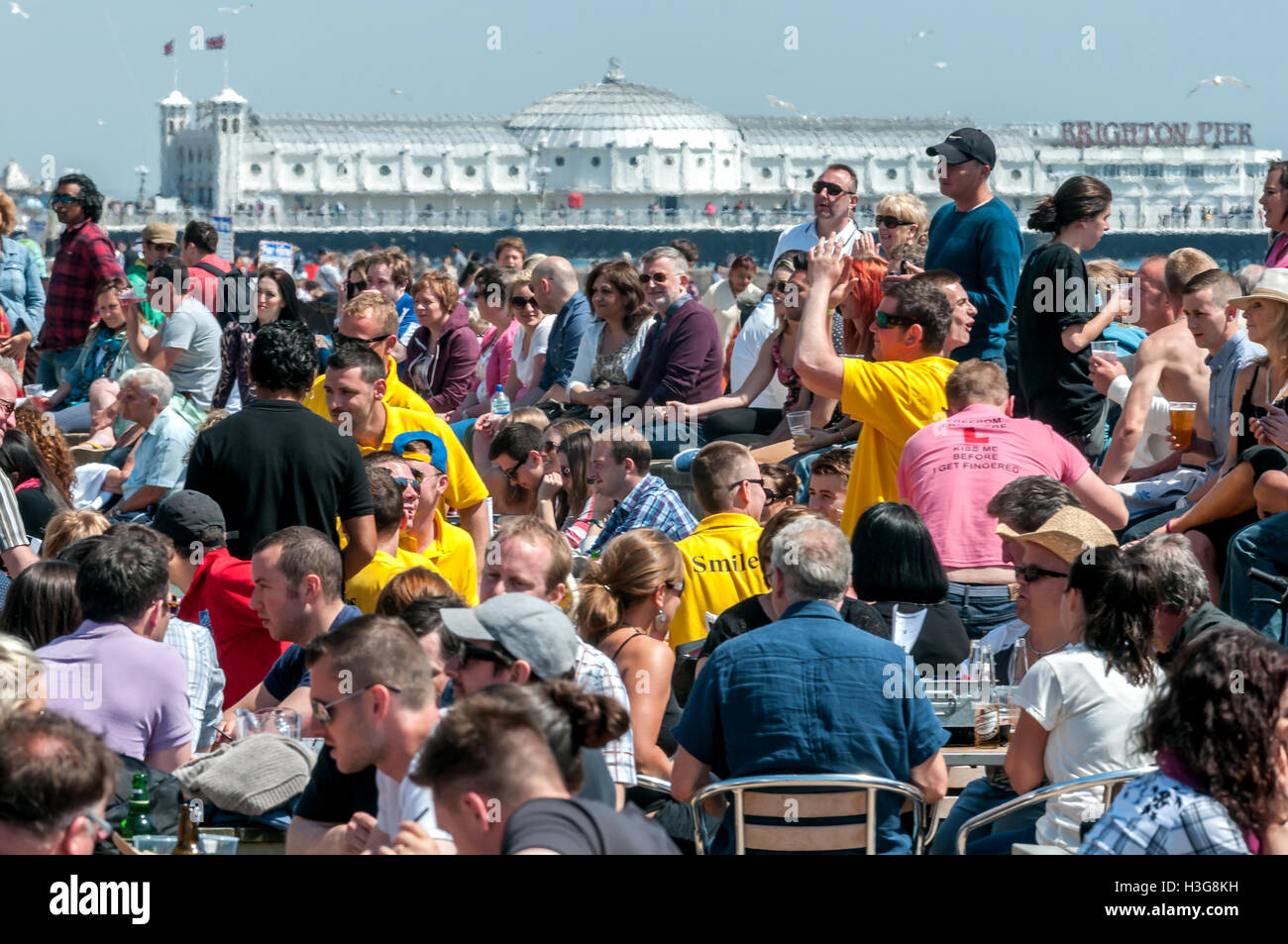 A crowded Brighton beach on a sunny spring day - Stock Image