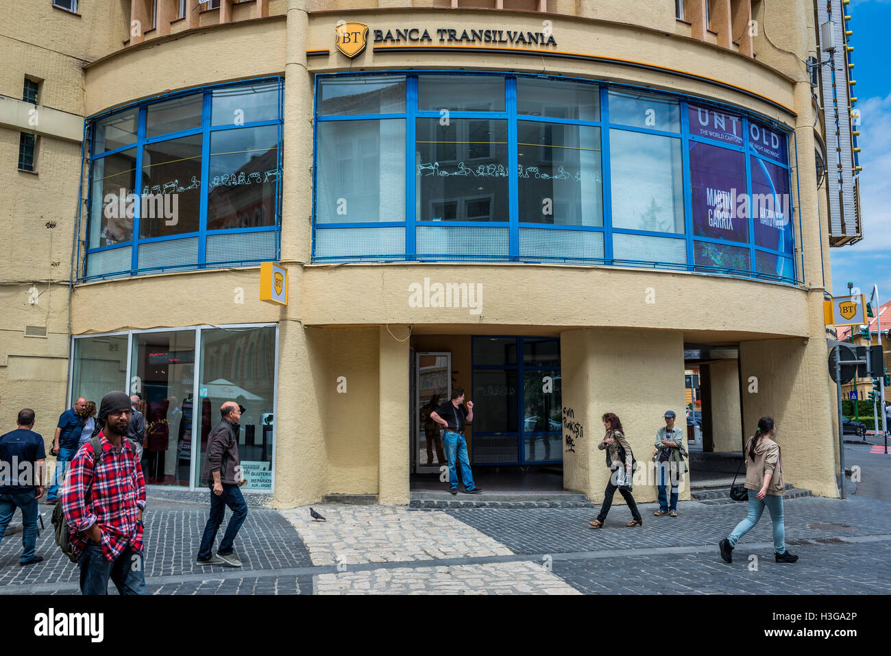 Banca Transilvania office at Republic Street, main pedestrian thoroughfare full of shops and restaurants in Brasov, - Stock Image