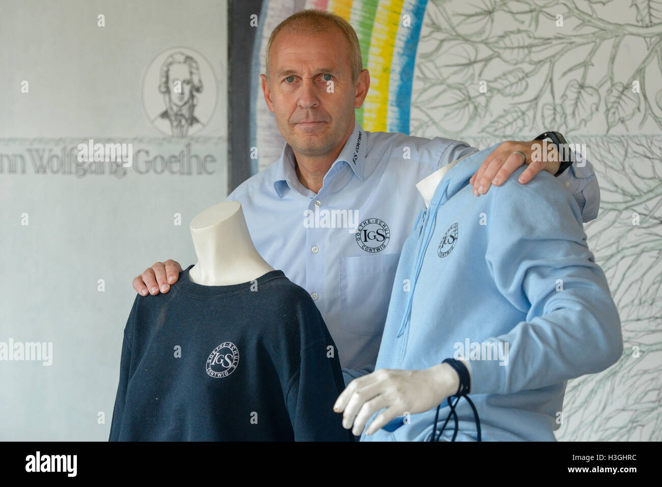Contwig, Germany. 07th Oct, 2016. Headmaster Thomas Hoechst standing between two dummies dressed in clothes bearing Stock Photo