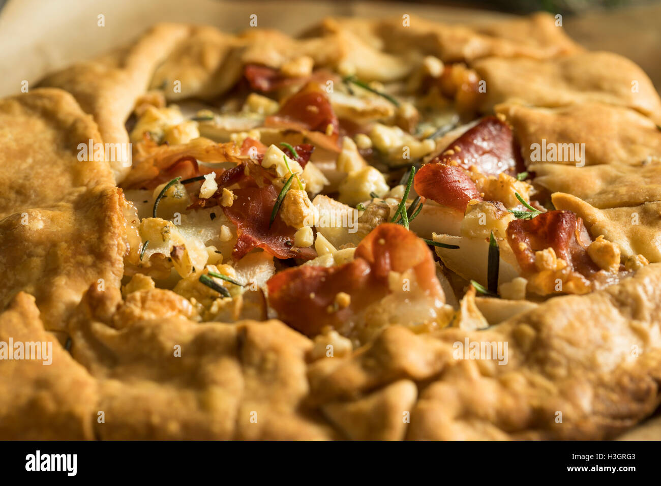 Savory Prosciutto Cheese and Pear Galette Ready to Eat - Stock Image