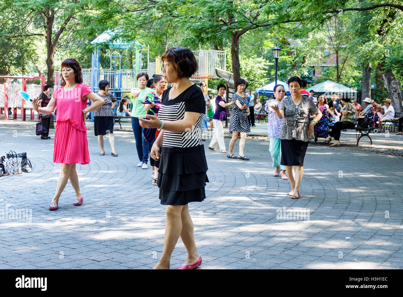 Lower Manhattan New York City NYC NY Chinatown Seward Park public park playground Tai Chi exercise Asian woman mature - Stock Image