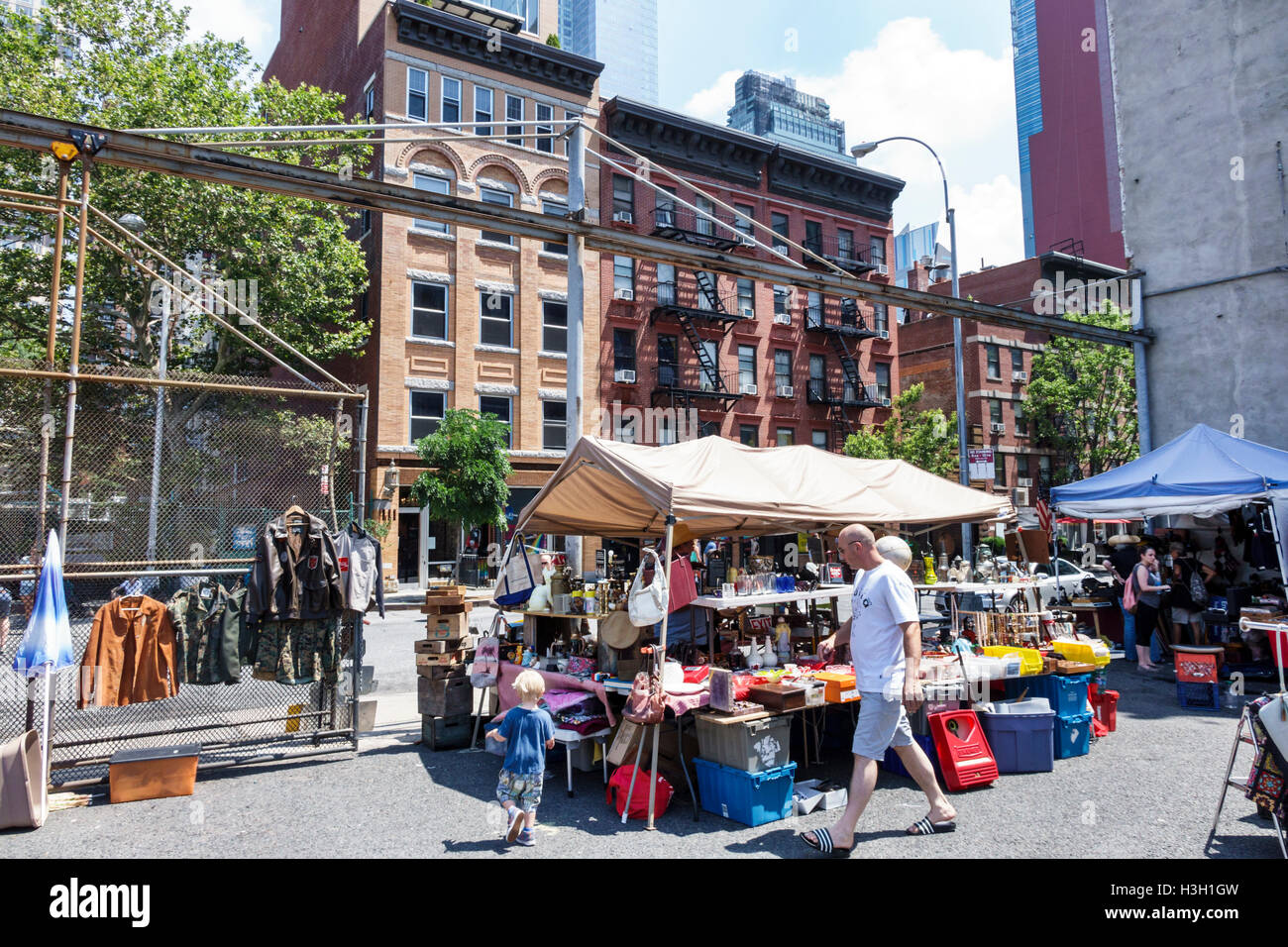Manhattan New York City NYC NY Hells Kitchen Flea Market Outdoor Shopping Vendors Stalls Sale Selling Vintage Home Decor Man Bo