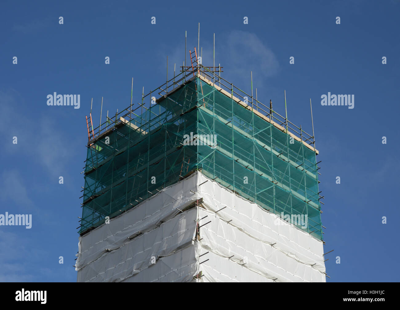 Sandblasting containment curtains protect the environment against airborne hazards during renovation of all saints - Stock Image