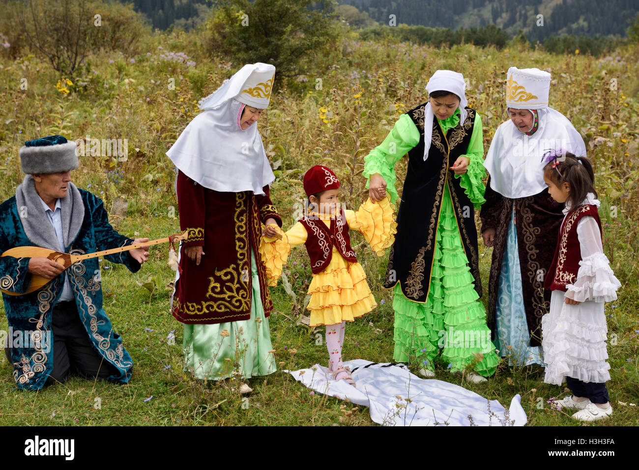 Steps after Tusau Kesu cutting the rope Kazakh traditional family ceremony blessing of young child - Stock Image