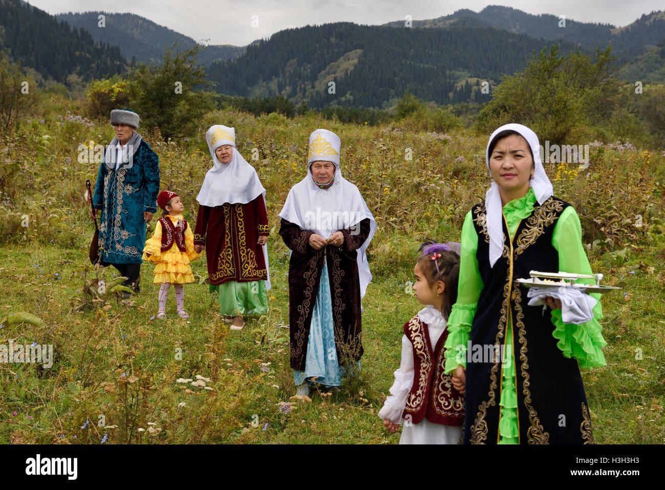 Kazakh family in field after Tusau Kesu ceremony at Huns Village near Almaty Kazakhstan - Stock Image