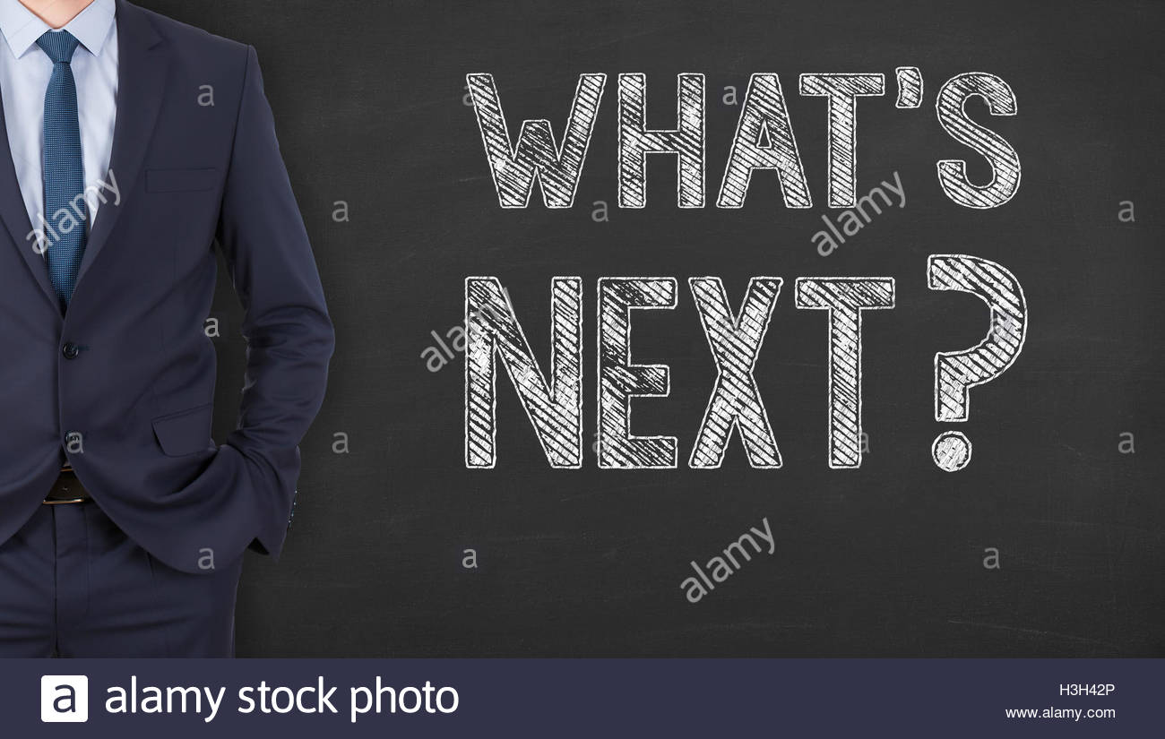 Writing What's Next on Chalkboard - Stock Image